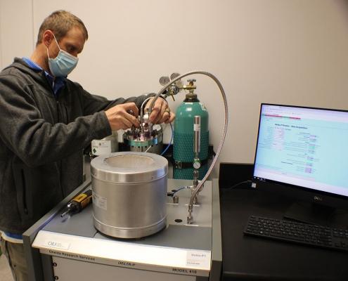 Dan assembling a Delta P Model 410 Getter Sorption Analyzer